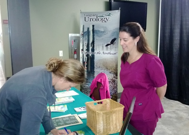 Danette Traver of Longview Urology chats with a Fibre Federal employee