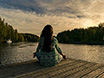 Spine LLC Self-Care guide with image of woman meditating on dock