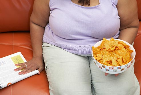 woman eating nacho chips