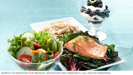 Dinner of fish, pasta, veggies and parfait